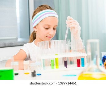 cute little girl with flasks for chemistry