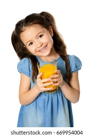 Cute little girl with glass of juice on white background