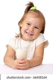 Cute little girl with a glass of milk, isolated over white