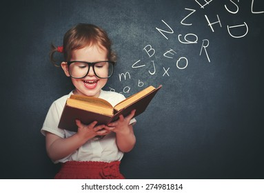 cute little girl with glasses reading a book with departing letters about Chalkboard