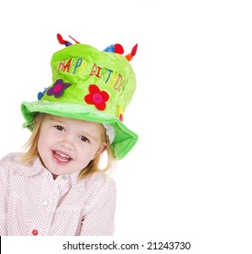 cute little girl with green hat celebrating her birthday