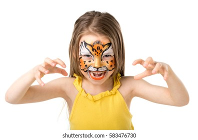 cute little girl growling like tiger with colorful painted face isolated on white background