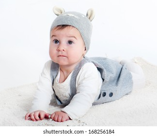 Cute little girl in a hat with ears on a white background