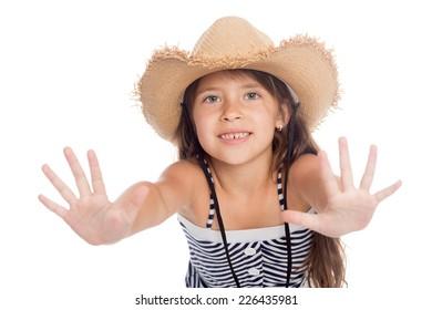 Cute little girl in a hat put forward hand.