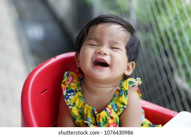 Cute little girl having fun outdoor and laughing.