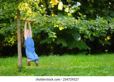 Cute little girl having fun in a park on a sunny summer day