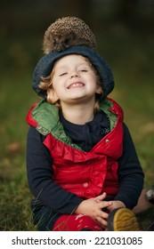 cute little girl with hedgehog on head