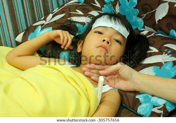 Cute little girl with high fever