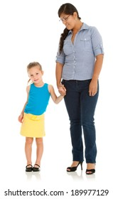 Cute little girl with Hispanic teacher. Studio shot on white with reflection.
