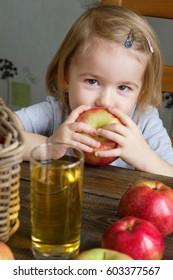 Cute little girl holding an apple