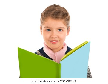 A cute little girl holding a big storybook looking at the camera and smiling. Isolated on white.