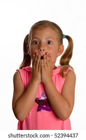 Cute little girl holding her hands across her mouth and showing surprise