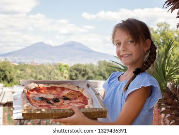 Cute little girl holding pizza