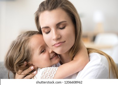 Cute little girl hug young mom, touching her face, showing love and care, millennial mother embrace small daughter, feeling sweet tender moment, enjoying time together. Family relationships concept
