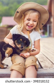 Cute little girl hugging dog puppy. Friendship and care concept
