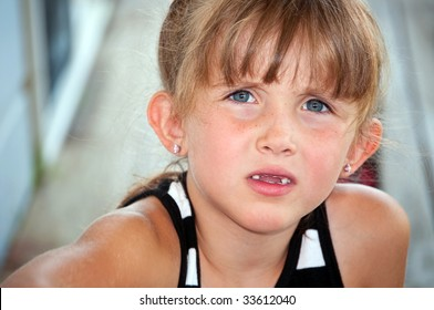 Cute little girl with inquisitive look