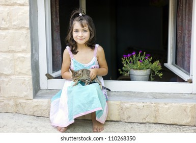 Cute little girl  and kitten to play out window