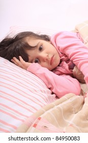 Cute little girl laying in bed and can't fall asleep