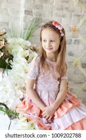 Cute little girl in a light spring studio