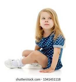 A cute little girl is looking up. The concept of emotions, happy childhood. Isolated on white background.