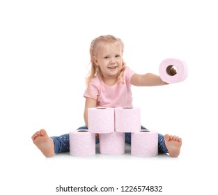 Cute little girl making toilet paper pyramid on white background