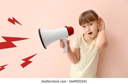 Cute little girl with megaphone trying to hear something on color background