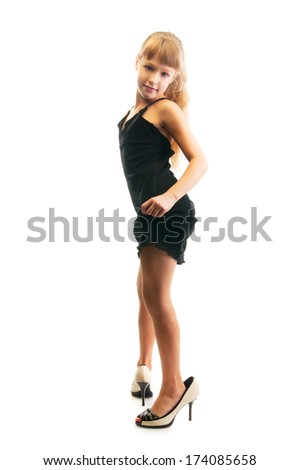 6bc04d21dc8 Cute little girl in mommy s big high heels shoes and black dress isolated  on white background