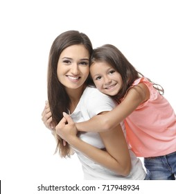 Cute little girl with mother on white background