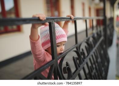 cute little girl on balcony