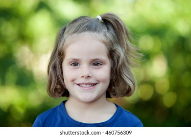 Cute little girl on the park in summer day