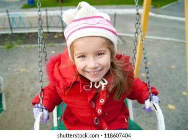 Cute little girl on a playground equipment