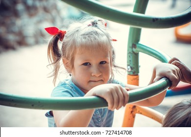 Cute little girl on the playground