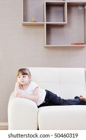 cute little girl on sofa at home