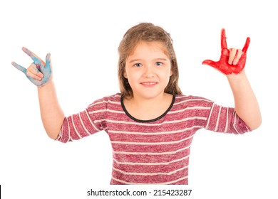 Cute little girl with painted hands showing the horns and smiling. Isolated on white.