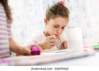 Cute little girl painting a picture