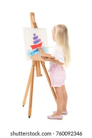 Cute little girl painting picture on canvas against white background