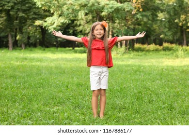 Cute little girl in park on summer day