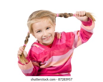 Cute little girl with a plaits on a white background close-up