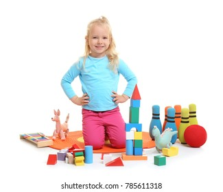 Cute little girl playing with building blocks on white background