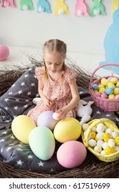 A cute little girl playing with Easter eggs, Easter theme