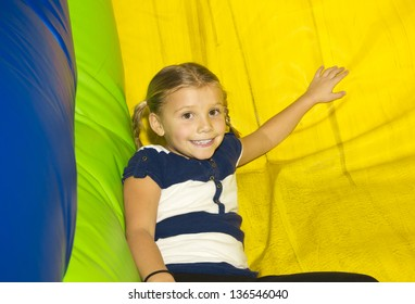 Cute little Girl playing on inflatable Side
