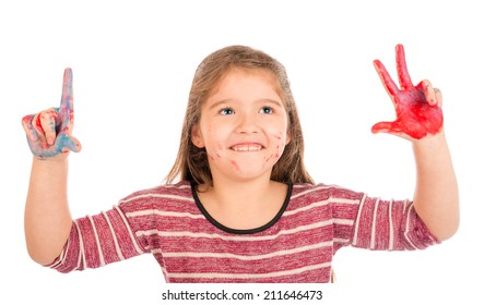 Cute little girl playing with red and blue paint showing two and three fingers.