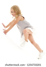 Cute little girl playing in the studio on the hill. Cyclorama. Isolated on white background.