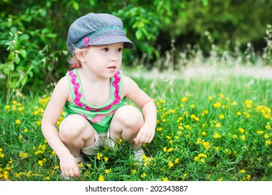 cute little girl playing in the summer park