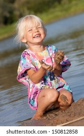 Cute little girl playing in water