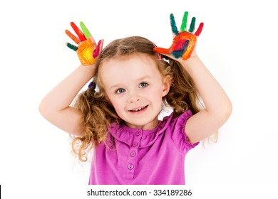 Cute little girl playing with watercolors