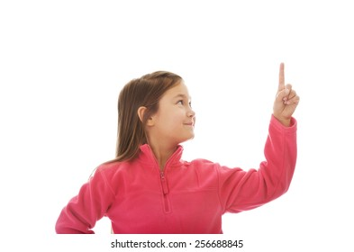Cute little girl pointing up