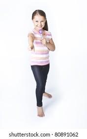 Cute little girl practicing being a pop star