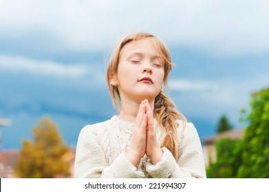 Cute little girl praying