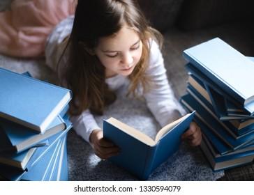 Cute Little girl reading book.